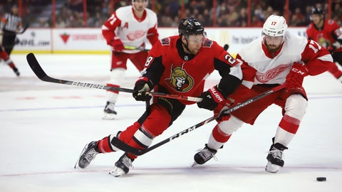 <p>               Ottawa Senators right wing Connor Brown (28) fights for possession of the puck with Detroit Red Wings defenseman Filip Hronek (17) during the second period of an NHL hockey game Wednesday, Oct. 23, 2019, in Ottawa, Ontario. (Fred Chartrand/The Canadian Press via AP)             </p>