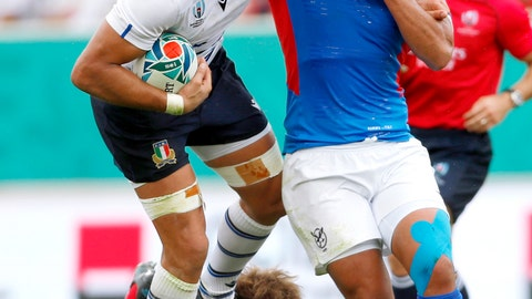 <p>               Italy's Sergio Parisse, left, carries the ball while being tackled by Namibia during the Rugby World Cup Pool B game between Italy and Namibia in Osaka, western Japan, Sunday, Sept. 22, 2019. (Ichiro Sakano/Kyodo News via AP)             </p>