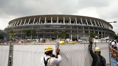 <p>               FILE - In this July 24, 2019, file, photo, workers adjust fences at the construction site of the New National Stadium, a venue for the opening and closing ceremonies at the Tokyo 2020 Olympics, in Tokyo. (AP Photo/Jae C. Hong, File)             </p>
