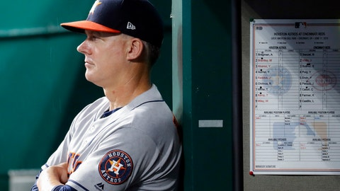 """<p>               FILE - In this June 17, 2019, file photo, Houston Astros manager AJ Hinch looks on from the dugout in the fifth inning of a baseball game against the Cincinnati Reds in Cincinnati. The AL champions have been dogged by allegations of spying, most recently during this year's ALCS against the Yankees. Houston players were suspected of whistling in the dugout to communicate pitch selection to batters, an allegation manager AJ Hinch called """"ridiculous."""" (AP Photo/John Minchillo, File)             </p>"""