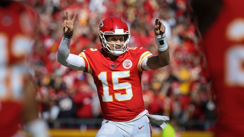KANSAS CITY, MO - OCTOBER 13: Kansas City Chiefs quarterback Patrick Mahomes (15) runs with 2 fingers on each hand after throwing a 46-yard touchdown pass to wide receiver Tyreek Hill (10) in the first quarter of an NFL matchup between the Houston Texans and Kansas City Chiefs on October 13, 2019 at Arrowhead Stadium in Kansas City, MO. (Photo by Scott Winters/Icon Sportswire via Getty Images)