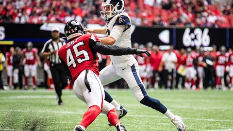 ATLANTA, GA - OCTOBER 20: Jared Goff #16 of the Los Angeles Rams rushes passed defender Deion Jones #45 of the Atlanta Falcons during the second half of a game at Mercedes-Benz Stadium on October 20, 2019 in Atlanta, Georgia. (Photo by Carmen Mandato/Getty Images)