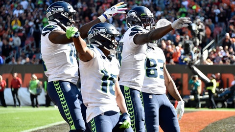 CLEVELAND, OHIO - OCTOBER 13: Tyler Lockett #16 D.K. Metcalf #14 Jaron Brown #18 and David Moore #83 of the Seattle Seahawks celebrate after Brown scored during the second quarter against the Cleveland Browns at FirstEnergy Stadium on October 13, 2019 in Cleveland, Ohio. (Photo by Jason Miller/Getty Images)