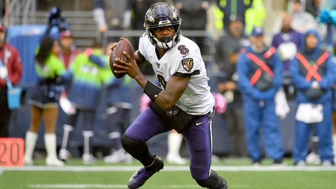 SEATTLE, WASHINGTON - OCTOBER 20: Lamar Jackson #8 of the Baltimore Ravens rolls out of the pocket during the first half of the game against the Seattle Seahawks at CenturyLink Field on October 20, 2019 in Seattle, Washington. (Photo by Alika Jenner/Getty Images)