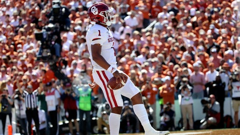 Oct 12, 2019; Dallas, TX, USA; Oklahoma Sooners quarterback Jalen Hurts (1) scores a touchdown during the second half against the Texas Longhorns at the Cotton Bowl. Mandatory Credit: Kevin Jairaj-USA TODAY Sports