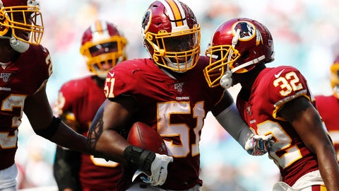 <p>               Washington Redskins linebacker Shaun Dion Hamilton (51) is congratulated after intercepting a pass, during the second half at an NFL football game against the Miami Dolphins, Sunday, Oct. 13, 2019, in Miami Gardens, Fla. (AP Photo/Brynn Anderson)             </p>