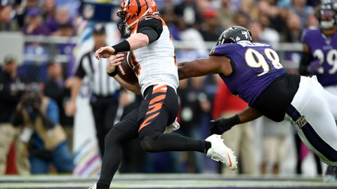 <p>               Cincinnati Bengals quarterback Andy Dalton, left, avoids a hit from Baltimore Ravens defensive end Brandon Williams (98) while scoring on a touchdown run during the second half of a NFL football game Sunday, Oct. 13, 2019, in Baltimore. The Ravens won 23-17. (AP Photo/Gail Burton)             </p>