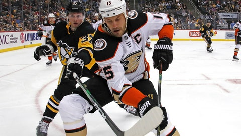 <p>               Anaheim Ducks' Ryan Getzlaf (15) goes after the puck in the corner with Pittsburgh Penguins' Sam Lafferty (37) during the second period of an NHL hockey game in Pittsburgh, Thursday, Oct. 10, 2019. (AP Photo/Gene J. Puskar)             </p>
