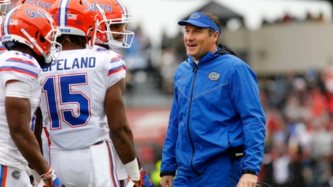 <p>               Florida's head coach Dan Mullen smiles with his players during in the first half of an NCAA college football game against South Carolina, Saturday, Oct. 19, 2019, in Columbia, SC. (AP Photo/Mic Smith)             </p>