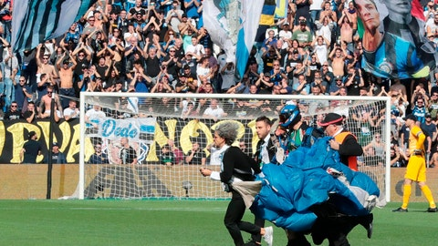 <p>               A parachutist who landed on the pitch during a Serie A soccer match between Sassuolo and Inter Milan is taken away after briefly disrupting the match at Mapei Stadium in Reggio Emilia, Italy, Sunday, Oct. 20, 2019. The intrusion came just before Romelu Lukaku was to take a penalty for the visitors. (Elisabetta Baracchi/ANSA via AP)             </p>