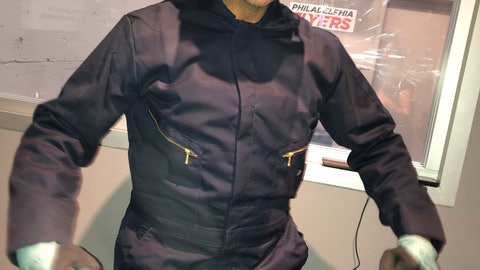 """<p>               Peter Caccioppoli, a Philadelphia Flyers fan from New York, wears a jumpsuit and safety helmet in the """"Rage Room"""" before the Philadelphia Flyers' NHL hockey game against the New Jersey Devils on Wednesday, Oct. 9, 2019, in Philadelphia. Caccioppoli swung a hockey stick at a place setting that would make Martha Stewart wince and later took aim on a fishbowl which had the """"NJ"""" Devils logo. Caccioppoli said he's been a partial season ticket holder """"for a very frustrating five years,"""" and was thrilled to take part in the demolition derby. (AP Photo/Dan Gelston)             </p>"""