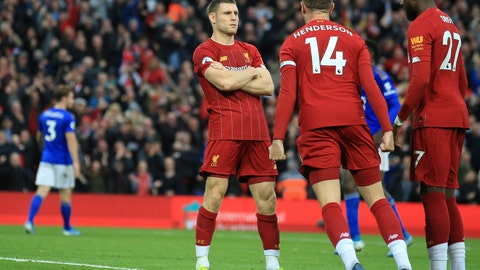 <p>               Liverpool's James Milner celebrates his wining goal with Liverpool's Jordan Henderson and Liverpool's Divock Origi during English Premier League soccer match between Liverpool and Leicester City in Anfield stadium in Liverpool, England, Saturday, Oct. 5, 2019. (AP Photo/Jon Super)             </p>