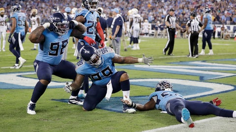 <p>               Tennessee Titans defenders Tennessee Titans defenders Jeffery Simmons (98) and Jurrell Casey (99) celebrate after stopping the Los Angeles Chargers on their final drive of the game in the fourth quarter of an NFL football game Sunday, Oct. 20, 2019, in Nashville, Tenn. The Titans won 23-20. (AP Photo/James Kenney)             </p>