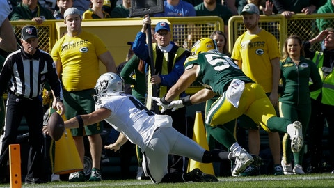 <p>               Oakland Raiders' Derek Carr loses the ball as he reaches for the end zone during the first half of an NFL football game against the Green Bay Packers Sunday, Oct. 20, 2019, in Green Bay, Wis. (AP Photo/Jeffrey Phelps)             </p>