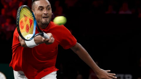 "<p>               FILE - In this Sept. 21, 2019 file photo, Nick Kyrgios returns a ball to Roger Federer during their singles match at the Laver Cup tennis event, in Geneva, Switzerland. Australia captain Lleyton Hewitt says he has been willing to overlook Kyrgios' recent outbursts on the ATP Tour to select the talented but wayward star in his team for the revamped Davis Cup finals. Kyrgios is currently serving six months probation on the ATP tour after a meltdown at the Cincinnati tournament in August and calling the ATP ""pretty corrupt"" during this year's US Open. (Salvatore Di Nolfi/Keystone via AP, File)             </p>"
