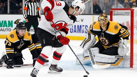 <p>               New Jersey Devils' Nico Hischier (13) tries to shoot against Boston Bruins goalie Tuukka Rask (40) during the first period of an NHL hockey game in Boston, Saturday, Oct. 12, 2019. (AP Photo/Michael Dwyer)             </p>