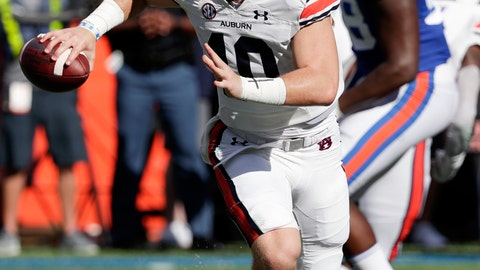 <p>               Auburn quarterback Bo Nix, left, looks for a receiver as he is rushed by Florida defensive lineman Luke Ancrum (98) during the first half of an NCAA college football game, Saturday, Oct. 5, 2019, in Gainesville, Fla. (AP Photo/John Raoux)             </p>