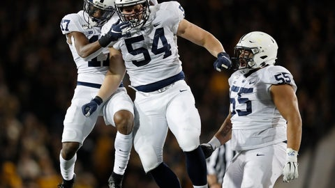 <p>               Penn State defensive tackle Robert Windsor, center, celebrates a sack with safety Garrett Taylor, left, and defensive tackle Antonio Shelton, right, during the second half of an NCAA college football game against Iowa, Saturday, Oct. 12, 2019, in Iowa City, Iowa. (AP Photo/Matthew Putney)             </p>