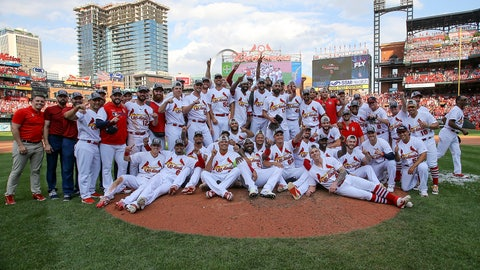 <p>               Members of the St. Louis Cardinals pose for a group picture as they celebrate their victory after a baseball game Sunday, Sept. 29, 2019, in St. Louis. The Cardinals clinched the NL Central on the final day of the regular season, to win their first division title since 2015 with a 9-0 victory over the Chicago Cubs. (AP Photo/Scott Kane)             </p>