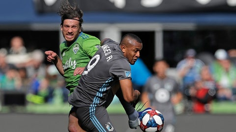 <p>               Seattle Sounders midfielder Gustav Svensson, left, battles for loose ball with Minnesota United forward Angelo Rodriguez, right, during the second half of an MLS soccer match, Sunday, Oct. 6, 2019, in Seattle. The Sounders won 1-0. (AP Photo/Ted S. Warren)             </p>