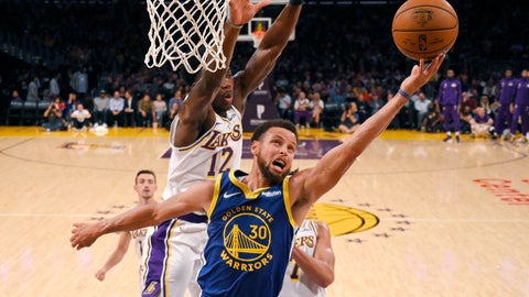 <p>               Golden State Warriors guard Stephen Curry, front, shoots as Los Angeles Lakers forward Devontae Cacok defends during the first half of a preseason NBA basketball game Monday, Oct. 14, 2019, in Los Angeles. (AP Photo/Mark J. Terrill)             </p>