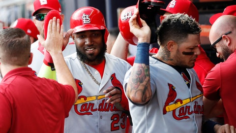 <p>               St. Louis Cardinals' Marcell Ozuna, left, and Yadier Molina, are greeted by teammates after scoring off Tommy Edman's doubles during the first inning of Game 5 of their National League Division Series baseball game against the Atlanta Braves, Wednesday, Oct. 9, 2019, in Atlanta. (AP Photo/John Bazemore)             </p>