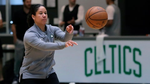 """<p>               FILE - In this July 1, 2019, file photo, Boston Celtics assistant coach Kara Lawson passes the ball at the team's training facility in Boston. Celtics guard Gordon Hayward said Lawson has already made her presence felt. """"She's been good as far as just the experience she has as a basketball player,"""" Hayward said. """"Reading the game and kind of little things she sees coaching on the sideline. Having somebody that well-versed in basketball, that experience is good."""" (AP Photo/Charles Krupa, File)             </p>"""