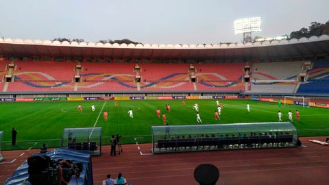 <p>               In this photo provided by the Korea Football Association, South and North Korean, wearing red uniforms, players play during their Asian zone Group H qualifying soccer match for the 2022 World Cup at Kim Il Sung Stadium in Pyongyang, North Korea, Tuesday, Oct. 15, 2019. South Korea soccer officials say they can't see a telecast of the historic World Cup qualifier in Pyongyang between their national team and North Korea, and think the game was proceeding at an empty Kim Il Sung Stadium. (The Korea Football Association via AP)             </p>