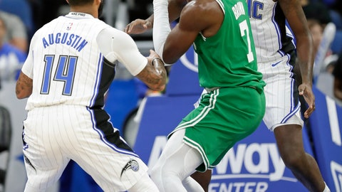 <p>               Boston Celtics' Jaylen Brown, center, looks to pass the ball as he is guarded by Orlando Magic's D.J. Augustin (14) and Al-Farouq Aminu , right, during the first half of an NBA preseason basketball game, Friday, Oct. 11, 2019, in Orlando, Fla. (AP Photo/John Raoux)             </p>