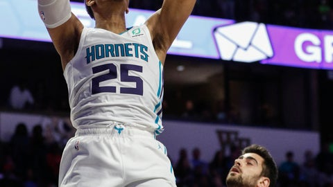 <p>               Charlotte Hornets forward PJ Washington (25) dunks over Philadelphia 76ers guard Furkan Korkmaz (30) in the second half of a preseason NBA basketball game in Winston-Salem, N.C., Friday, Oct. 11, 2019. (AP Photo/Nell Redmond)             </p>