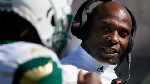 <p>               South Florida head coach Charlie Strong talks with quarterback Jordan McCloud during the first half of an NCAA college football game against Connecticut in East Hartford, Conn., Saturday, Oct. 5, 2019. (AP Photo/Michael Dwyer)             </p>