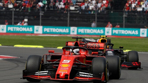 <p>               Ferrari driver Sebastian Vettel, of Germany, drives out of a curve during the Formula One Mexico Grand Prix auto race at the Hermanos Rodriguez racetrack in Mexico City, Sunday, Oct. 27, 2019. (AP Photo/Rebecca Blackwell)             </p>