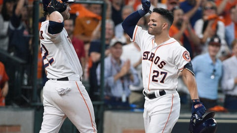 <p>               Houston Astros' Jose Altuve (27)  is congratulated by teammate Josh Reddick (22) after hitting a two-run home run against the Tampa Bay Rays in the fifth inning during Game 1 in baseball's American League Division Series in Houston, Friday, Oct. 4, 2019. (AP Photo/Michael Wyke)             </p>