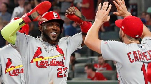 <p>               CORRECTS TO DOUBLE, INSTEAD OF SINGLE - St. Louis Cardinals' Marcell Ozuna (23) celebrates his two-run double against the Atlanta Braves in the ninth inning during Game 1 of a best-of-five National League Division Series, Thursday, Oct. 3, 2019, in Atlanta. (AP Photo/John Bazemore)             </p>