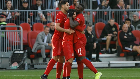 <p>               Toronto FC midfielder Alejandro Pozuelo, middle, celebrates his goal against the Columbus Crew with defender Omar Gonzalez, left, and forward Jozy Altidore (17) during the second half of an MLS soccer match in Toronto, Sunday, Oct. 6, 2019. (Cole Burston/The Canadian Press via AP)             </p>
