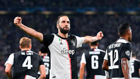 <p>               Juventus' Gonzalo Higuain celebrates after scoring a goal during the UEFA Champions League group D soccer match against Bayer Leverkusen at the Allianz Stadium in Turin, Italy, Tuesday, Oct. 2019. (Alessandro Di Marco/ANSA via AP)             </p>