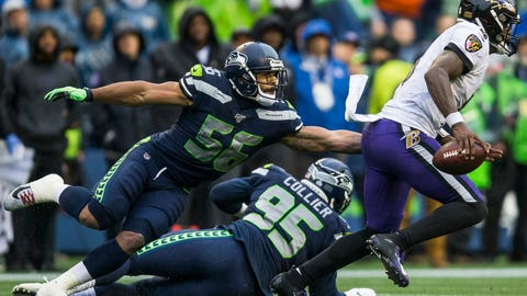 <p>               Seattle Seahawks' Mychal Kendricks (56) reaches to try and tackle Baltimore Ravens' Lamar Jackson, right, during an NFL football game Sunday, Oct. 20, 2019, in Seattle, Wash. (Olivia Vanni/The Herald via AP)             </p>