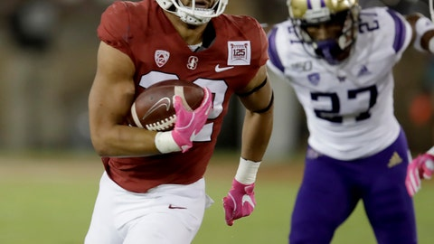<p>               Stanford's Cameron Scarlett, left, runs past Washington's Keith Taylor (27) during the first half of an NCAA college football game Saturday, Oct. 5, 2019, in Stanford, Calif. (AP Photo/Ben Margot)             </p>