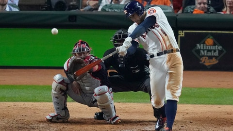 <p>               Houston Astros' George Springer hits an RBI double during the eighth inning of Game 1 of the baseball World Series against the Washington Nationals Tuesday, Oct. 22, 2019, in Houston. (AP Photo/Eric Gay)             </p>