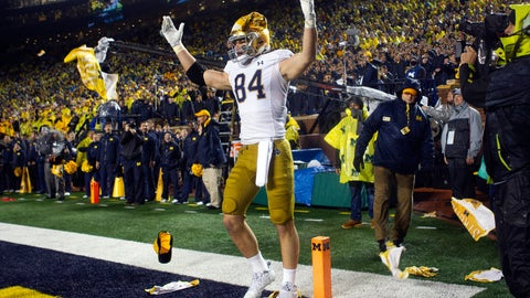 <p>               Notre Dame tight end Cole Kmet (84) receives debris thrown at him from the Michigan Stadium fans as he celebrates a touchdown in the third quarter of an NCAA college football game against Michigan in Ann Arbor, Mich., Saturday, Oct. 26, 2019. Michigan won 45-14. (AP Photo/Tony Ding)             </p>
