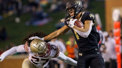 <p>               Wake Forest wide receiver Sage Surratt, right, stiff arms Florida State defensive back Akeem Dent after a catch in the first half of an NCAA college football game in Winston-Salem, N.C., Saturday, Oct. 19, 2019. (AP Photo/Nell Redmond)             </p>