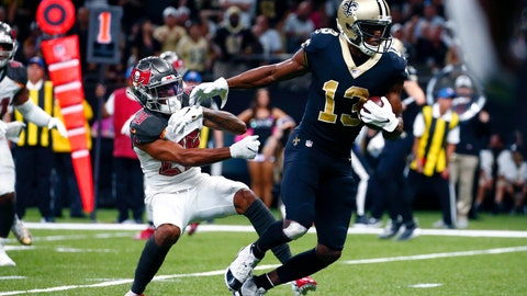 <p>               New Orleans Saints wide receiver Michael Thomas (13) breaks away from Tampa Bay Buccaneers defensive back Sean Murphy-Bunting on a touchdown reception in the second half of an NFL football game in New Orleans, Sunday, Oct. 6, 2019. (AP Photo/Butch Dill)             </p>