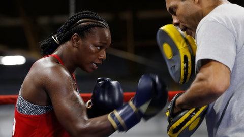 <p>               Claressa Shields spars with trainer John David Jackson during a training session, Wednesday, Oct. 2, 2019, in Detroit. Shields will fight Croatian boxer Ivana Habazin for the vacant World Boxing Organization Junior Middleweight title in Flint, Mich., on Saturday night. (AP Photo/Carlos Osorio)             </p>