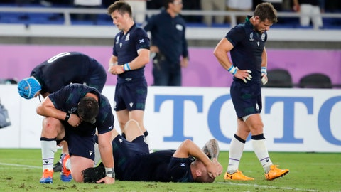 <p>               Scotland players react following their 28-21 loss to Japan in their Rugby World Cup Pool A game at International Stadium in Yokohama, Japan, Sunday, Oct. 13, 2019. (AP Photo/Christophe Ena)             </p>