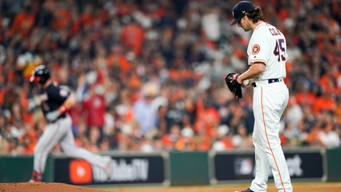 <p>               Houston Astros starting pitcher Gerrit Cole reacts after giving up a home run to Washington Nationals' Ryan Zimmerman during the second inning of Game 1 of the baseball World Series Tuesday, Oct. 22, 2019, in Houston. (AP Photo/David J. Phillip)             </p>