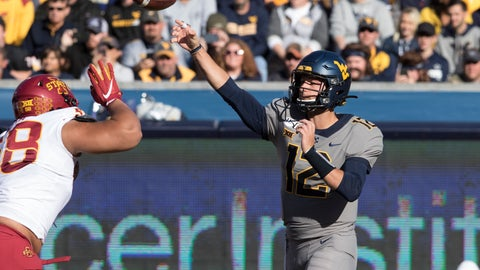 <p>               West Virginia quarterback Austin Kendall (12) attempts a pass during the first half of an NCAA college football game against Iowa State Saturday, Oct. 12, 2019, in Morgantown, W.Va. (AP Photo/Raymond Thompson)             </p>