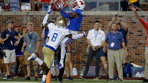 <p>               SMU wide receiver James Proche, in blue, catches a touchdown pass while Tulsa safety Brandon Johnson (8) defends during the third overtime of an NCAA college football game Saturday, Oct. 5, 2019, in Dallas. SMU beat Tulsa 43-37. (AP Photo/Roger Steinman)             </p>