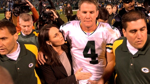<p>               FILE - In this Dec. 22, 2003, file photo, Green Bay Packers quarterback Brett Favre is escorted off the field with his wife, Deanna, after the Packers defeated the Oakland Raiders 41-7 in an NFL football game in Oakland, Calif. When it comes to emotional games, his four-touchdown against the Raiders the day after his father's death in 2003 stands out above all the rest.  (AP Photo/Paul Sakuma, File)             </p>