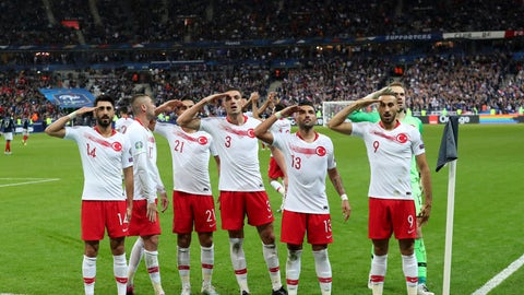 <p>               Turkey's players salute as they celebrate a goal against France during the Euro 2020 group H qualifying soccer match between France and Turkey at Stade de France at Saint Denis, north of Paris, France, Monday, Oct. 14, 2019. (AP Photo/Thibault Camus)             </p>