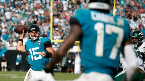 <p>               Jacksonville Jaguars quarterback Gardner Minshew II (15) throws a pass to wide receiver D.J. Chark (17) for a touchdown against the New York Jets during the second half of an NFL football game, Sunday, Oct. 27, 2019, in Jacksonville, Fla. (AP Photo/Stephen B. Morton)             </p>